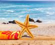 étoile de mer et serviette sur plage de la Réunion