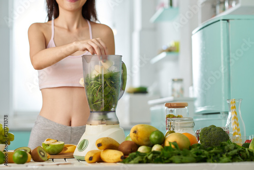 Preparing smoothie,