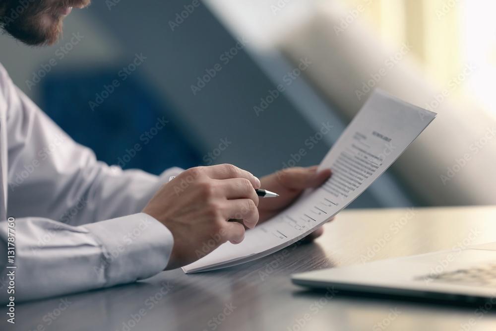 Fototapeta Businessman reading documents