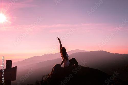 Fototapety, obrazy: The silhouette of a woman Happy mountain morning sunrise.