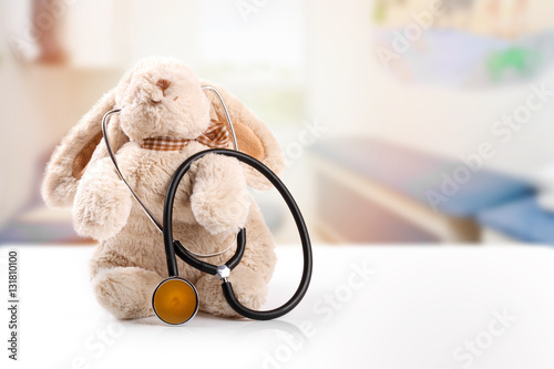 Fotografia  children doctor concept - rabbit with stethoscope. copy space