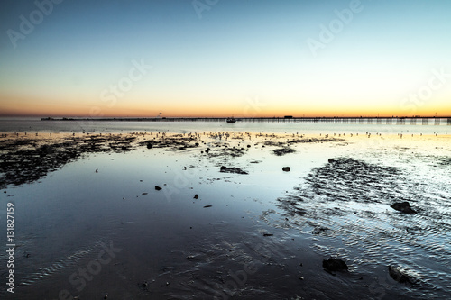 Photo  Tide out Southend Pier at Sunset