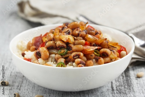 Fotografering Homemade Hoppin john or carolina Peas served in a white bowl, selective focus
