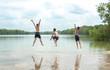 canvas print picture - Young boy jumping into lake.