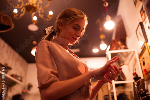 Young girl observing accessories in shop