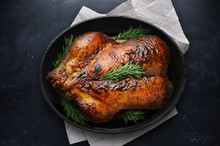 Roasted Thanksgiving Day Turkey In Black Pot On Table