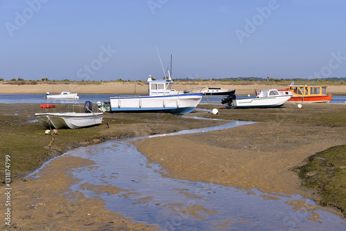 Poster Aeroport Boats at low tide at Cap-Ferret, ostreicole commune located on shore of Arcachon Bay, in the Gironde department in southwestern France.