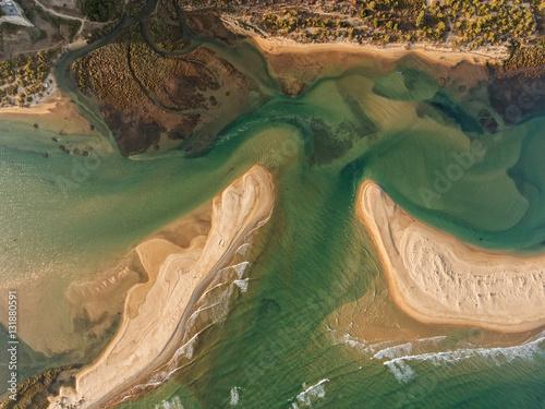 Fotografía  Aerial. Sandy Bay and waves filmed from the sky.