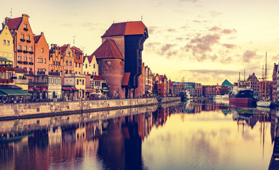 Colourful historic houses near Motlawa river in port of Gdansk,