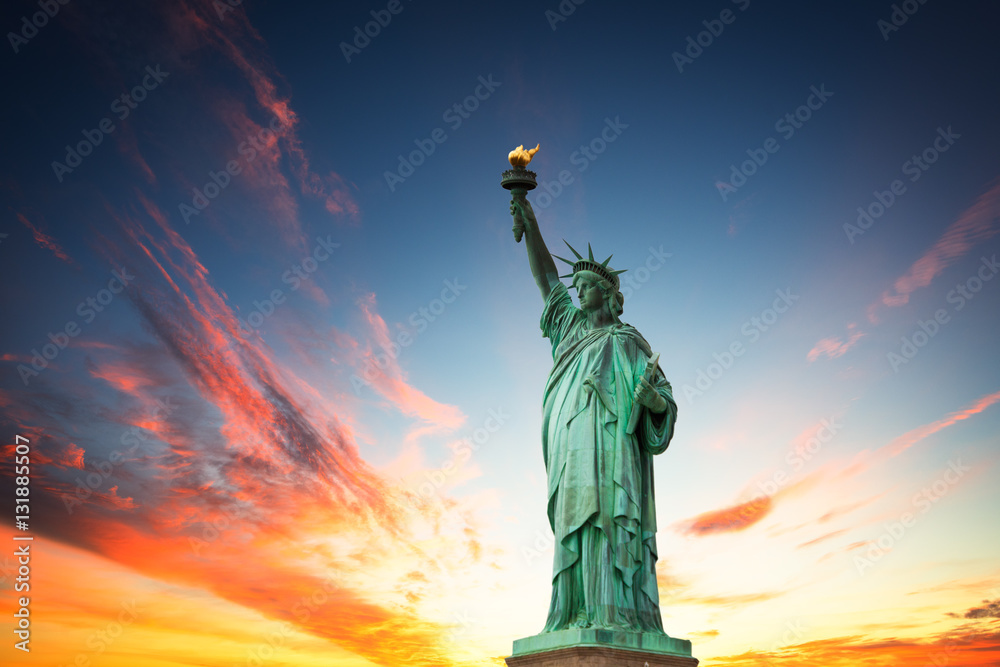 Photo  New York City, The Statue of Liberty in a colorful sunset