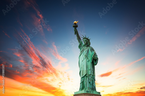Fototapeta New York City, The Statue of Liberty in a colorful sunset