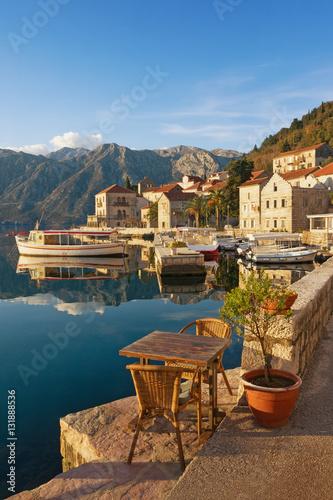 Foto auf Gartenposter Stadt am Wasser Embankment of Perast town on a sunny winter day. Bay of Kotor, Montenegro