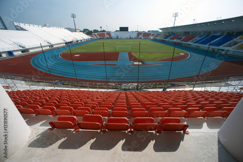 Foto op Plexiglas Stadion Colorful of stadium seats in background.