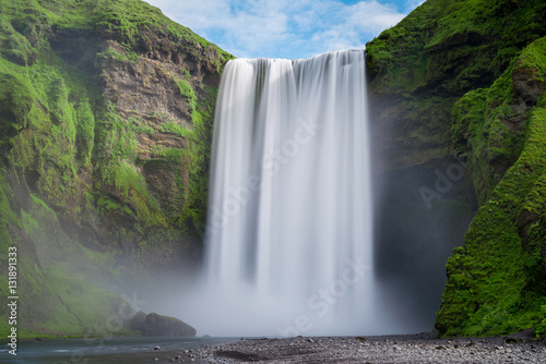 Fotobehang Watervallen Skogafoss waterfall long exposure