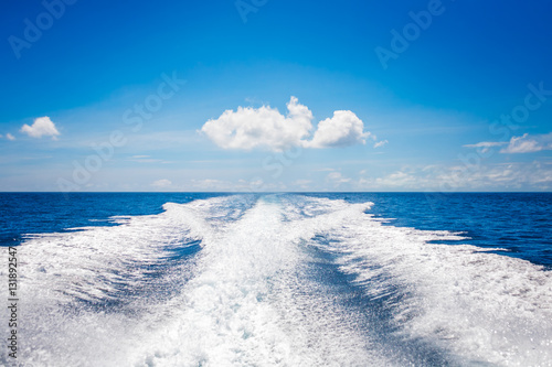 Foto  Background water surface behind of fast moving motor boat