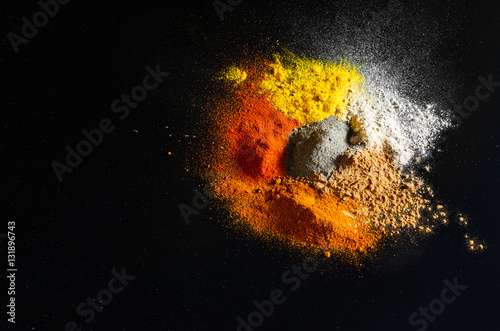 Canvas Prints Spices Spilled powder spices on black