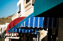 Colorful Awnings On Adjoining Small Shops