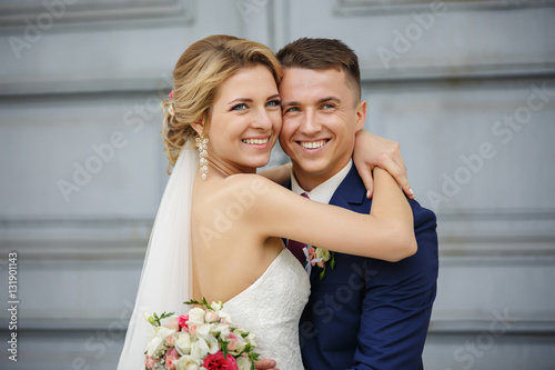 Stampa su Tela Wedding couple, portrait of happy bride and groom on background with copy space