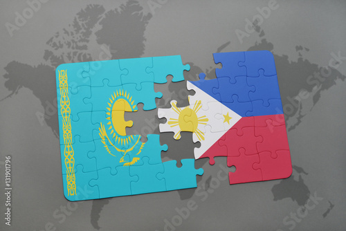 puzzle with the national flag of kazakhstan and philippines on a ...