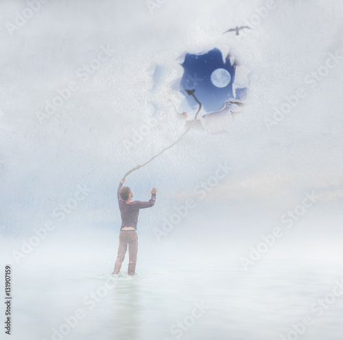 A guy is standing near the window trying to go up and looking outside, imagining boundless space with moon and stars Poster