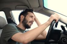 Portrait Of Handsome Hopeless Man Driving Car