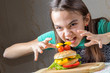girl eagerly pounced on a hamburger, holding out her arms to him with a crooked fingers
