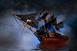 canvas print picture - Model Pirate Ship with fog and water