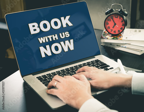 Online Travel Agency website Book Now on computer screen.