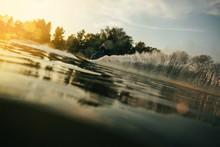 Man Water Skiing At Sunset