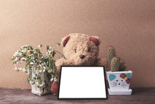 Vintage Teddy Bear Hold Blank Frame With Cactus And Dried Chamomile Flower On Old Wooden Table For Mocup Your Display Montage.