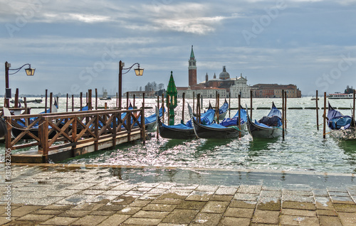 Spoed Foto op Canvas Gondolas Traditional gondolas with the bell tower of the Saint Giorgio Maggiore Church on background (view from San Marco embankment) - Venice, Italy