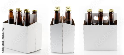 Six bottles of beer in cardboard carrier Canvas Print