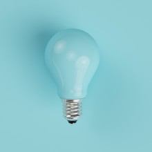 Blue Pastel Light Bulb On Blue Pastel Background. Minimal Concept. Top View.