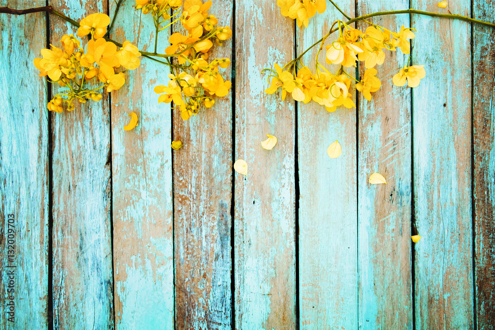 Yellow flowers on vintage wooden background, border design. vintage color tone - concept flower of spring or summer background