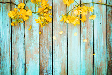 Yellow Flowers On Vintage Wood...