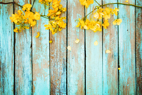 Fotobehang Bloemen Yellow flowers on vintage wooden background, border design. vintage color tone - concept flower of spring or summer background