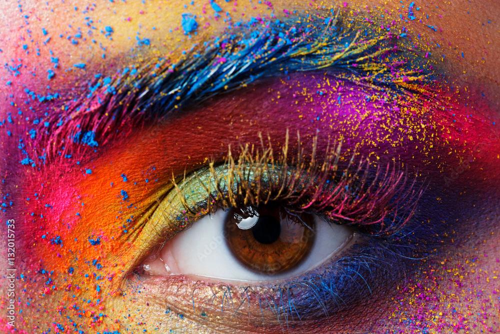 Fototapeta Close up view of female eye with bright multicolored fashion mak