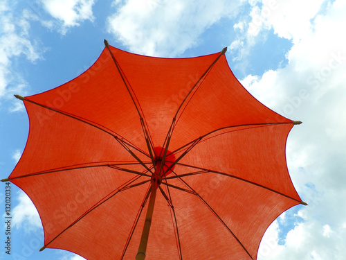 7ee8872e1 One red colored parasol against vivid blue sky and white cloud - Buy ...