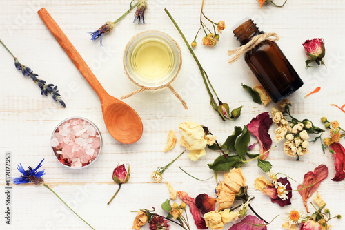 Photo  Herbal cosmetic ingredients top view wooden background
