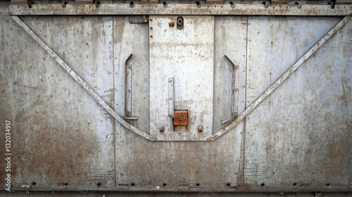 Fototapety, obrazy: Abstract grungy metal surface and lock on rusty iron door of dining car train. Vintage train concept.