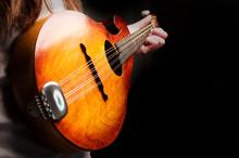 Close Up Of Woman Playing Mandolin