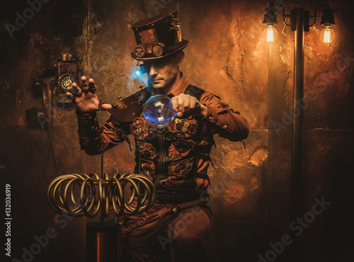Photo  Steampunk man with Tesla coil on vintage steampunk background