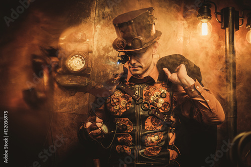 portrait of steampunk man with various mechanical devices on vintage