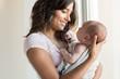 Leinwandbild Motiv Woman with newborn baby