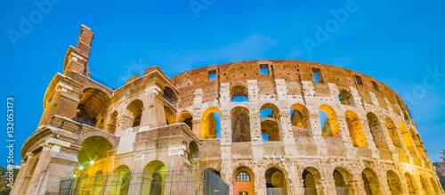Fotografia, Obraz  Dusk view of Colosseum in Rome, Italy