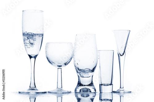 Papiers peints Eau Various glasses with transparent liquid
