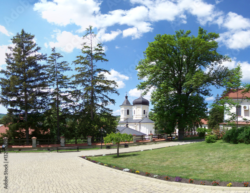 Fotografiet Capriana monastery on the background the stone church, built in Moldavian style