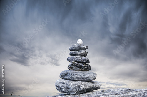 Leinwand Poster Cairn and Stormy Sky