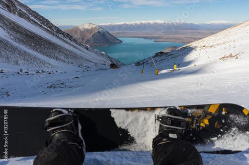 Photo  Snowboarder sitting on Ohau Snow Fields