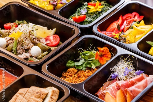 Fotobehang Kruidenierswinkel Healthy food and diet concept, restaurant dish delivery. Take away of fitness meal. Weight loss nutrition in foil boxes. Steamed veal with cous and vegetables at wood